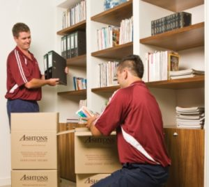 2 Removalists packing for an office relocation